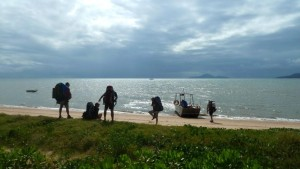 Hiking through beach for their premier walk through the Thorsborne Trails from Hinchinbrook Islands to Thorsborne Trails