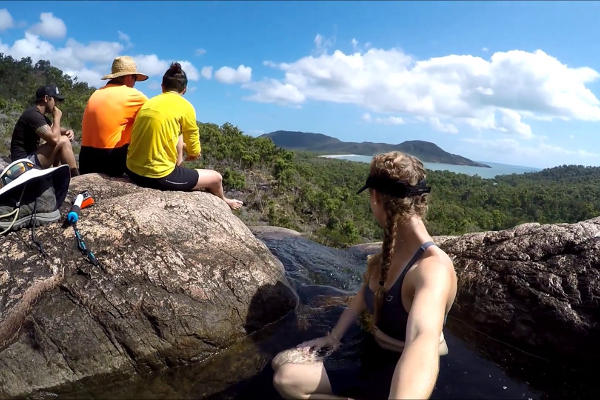 Four hikers enjoying their hiking through the Thorsborne Trail of Hinchinbrook Island